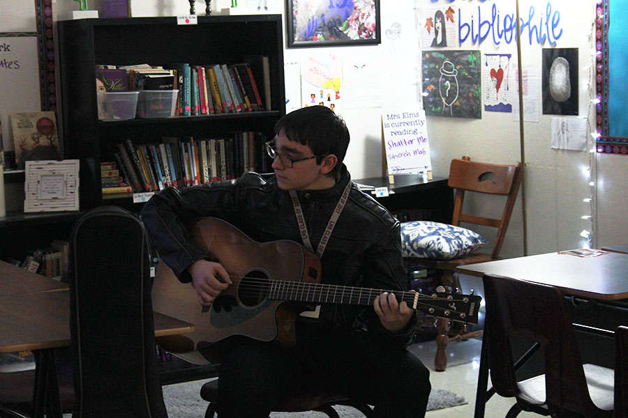 Guitar club president senior Dalton Baham practices with his guitar during the club meeting on Wednesday, Jan. 30.