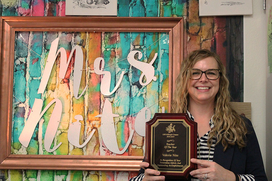 Fashion and interior design teacher Valerie Nite proudly displays her 2018-2019 Killough Teacher of the Year award.