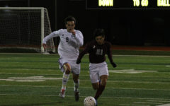 Junior forward Ethan Carbajal (21) runs after the ball in effort to regain control of it.