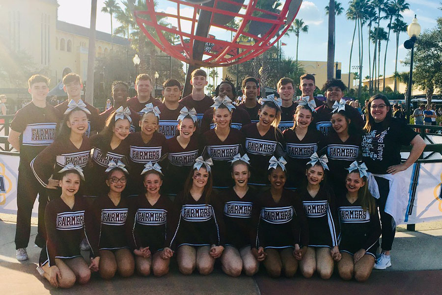 The cheer team poses outside of the ESPN Wide World of Sports Complex in Osceola County, Florida. Courtesy of LHS Cheer.
