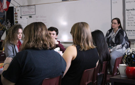 Students from lit mag listen to a peer's poem during B-block on Thursday, Feb. 7.