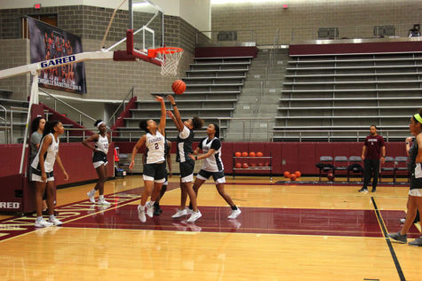 Freshman guard Deucee Reed (2), senior guard Anessa Boyd (23) and sophomore guard Haley Allen (30) run through team drills during first period practice on Thursday, Feb. 7.