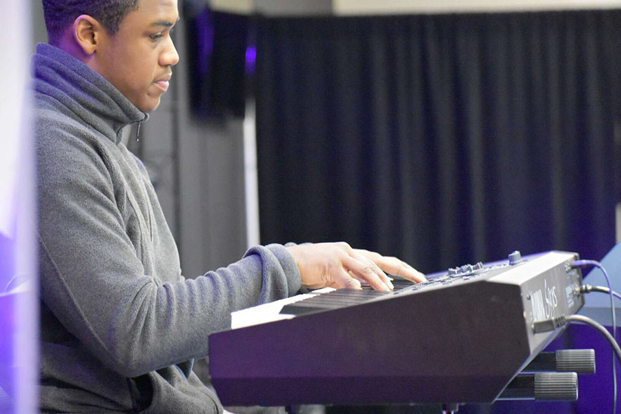 Senior Jeremiah Thomas plays his piano during church. Courtesy of Brandon Thomas.
