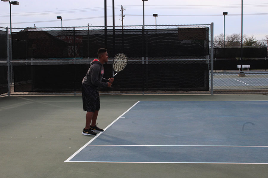 Sophomore Nicholas Ward prepares to receive a serve during practice on Wednesday, Feb. 13.