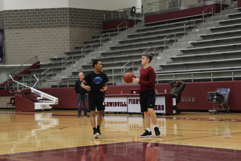 Sophomore point guard Kylin Green practices with junior shooting guard Austin Pugh on Friday, March 1.