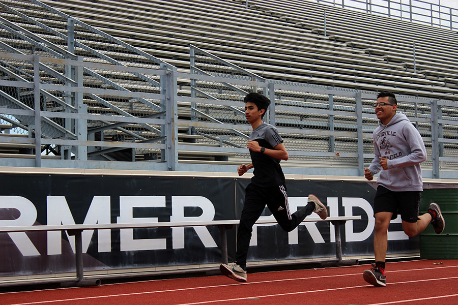 Juniors Alan Salinas and Elias Gonsalez practice during fourth period on Tuesday, March 19 for their upcoming track meet.