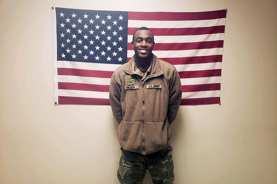 Myles Wilson poses in front of the American flag. Courtesy of Myles Wilson.