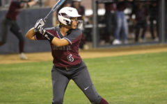 Senior Haven Grider (5) waits for the pitch during the game against Coppell on Friday, April 9.