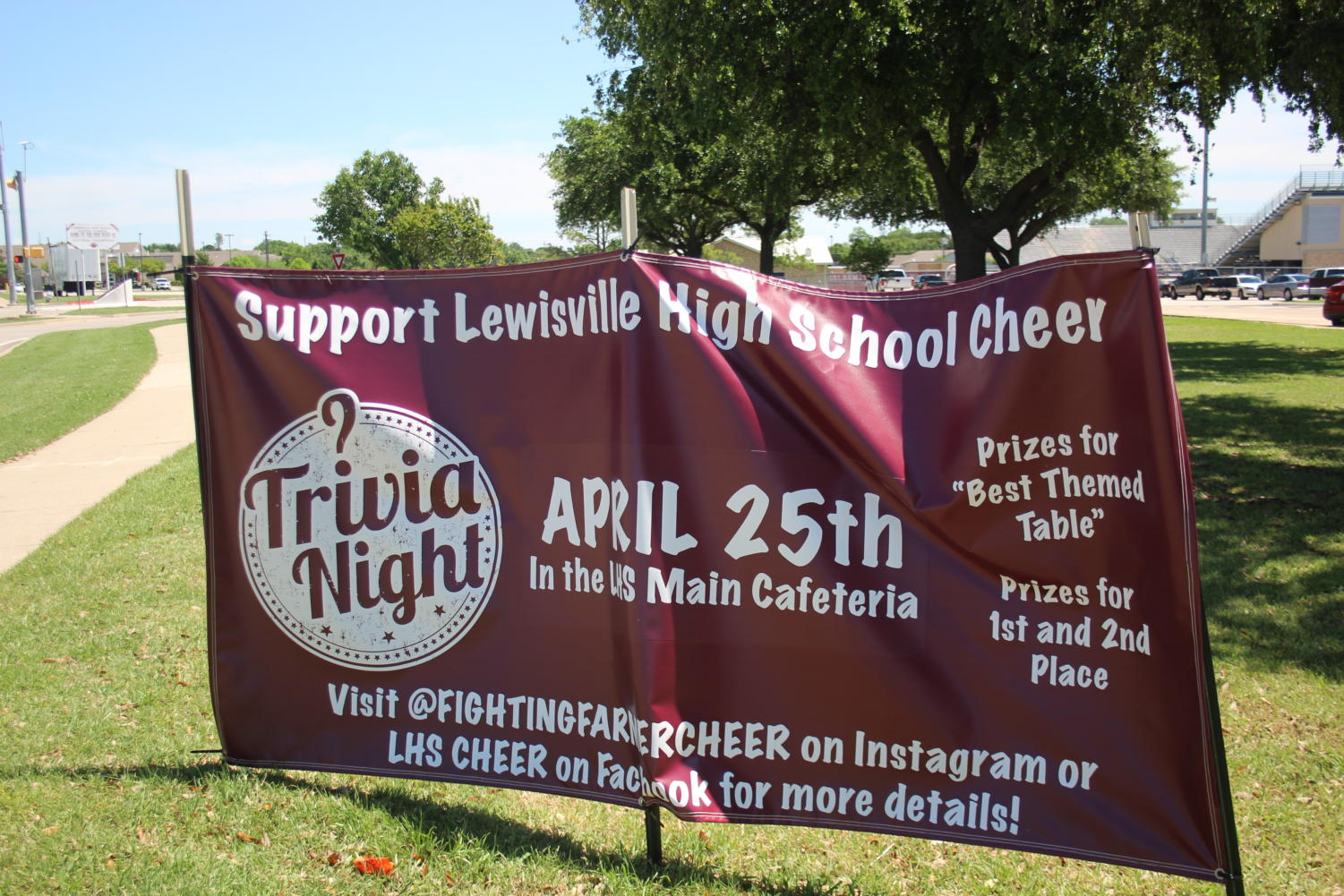 A sign is displayed at the entrance of the school to attract more attendees to cheer's trivia night on Thursday, April 25.