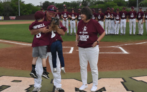 Baseball head coach Mike Campbell celebrates his 45-year career in coaching before the home game against Hebron on Tuesday, April 12.