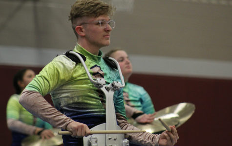 Junior Brett Myers focuses as he plays his snare drum during the community performance on Friday, April 5.