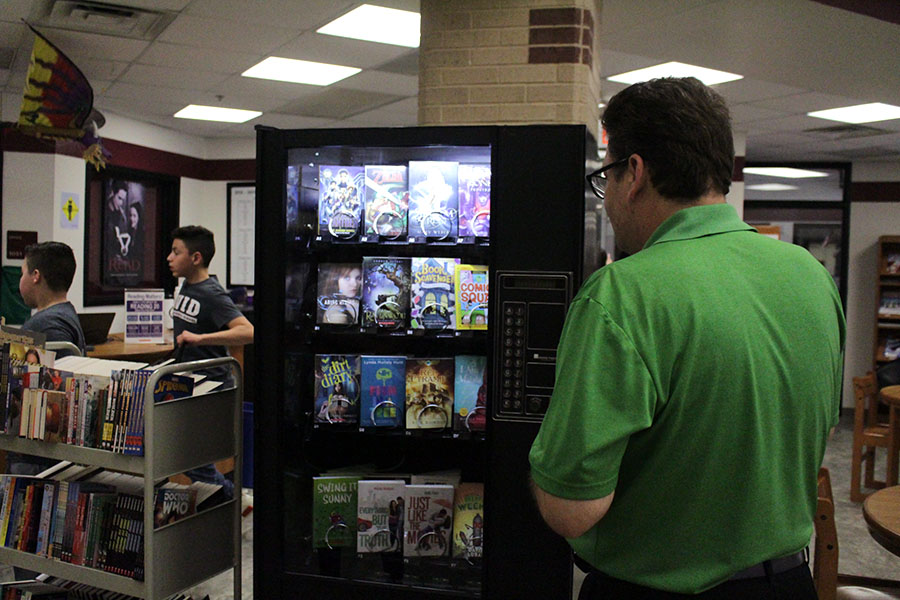 Durham's school librarian Brian Harvey looks at the selection of books in the vending machine.