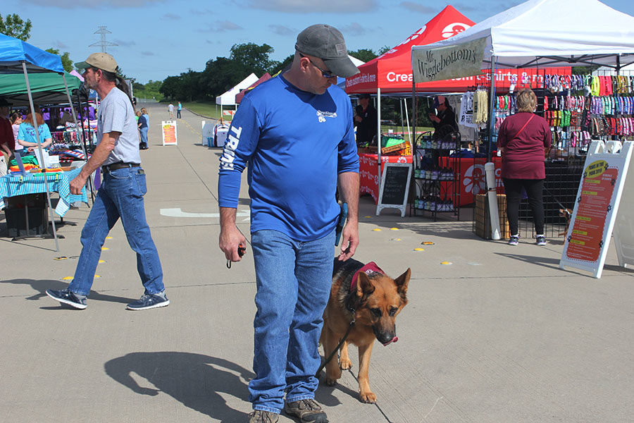 Off+Leash+vendor+Justin+Ray+walks+his+rescue+dog+Joe+to+demonstrate+positive+behavior+to+the+public+at+the+annual+Paws+in+the+Park+event+on+Saturday%2C+May+4.