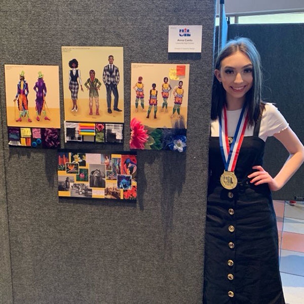 Senior Anna Cantu stands next to her first place theatrical design work. Courtesy of Laura McNary.