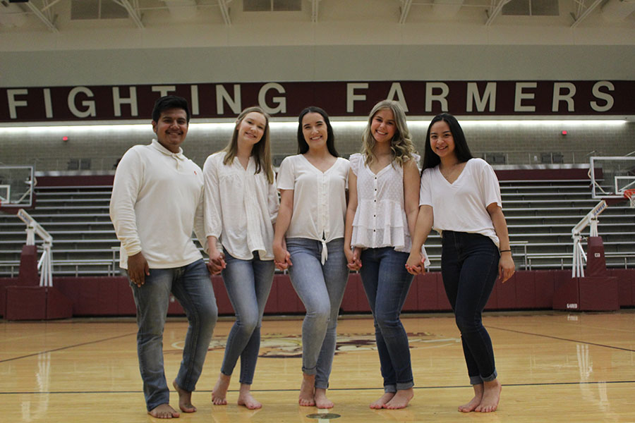 New Farmerette captain, junior Taylor Dill (middle), is surrounded by new senior lieutenants Erick Sanchez, Alexa Wolff, Carolyn Vaughan and junior lieutenant Trinity Darby.