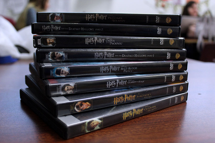 The Harry Potter movies lay stacked on a table in order of their ranking.