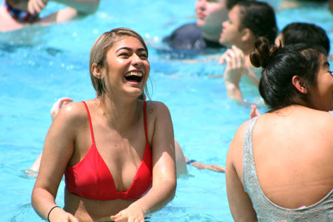 Senior Stephany Salas laughs with her friends in the pool.