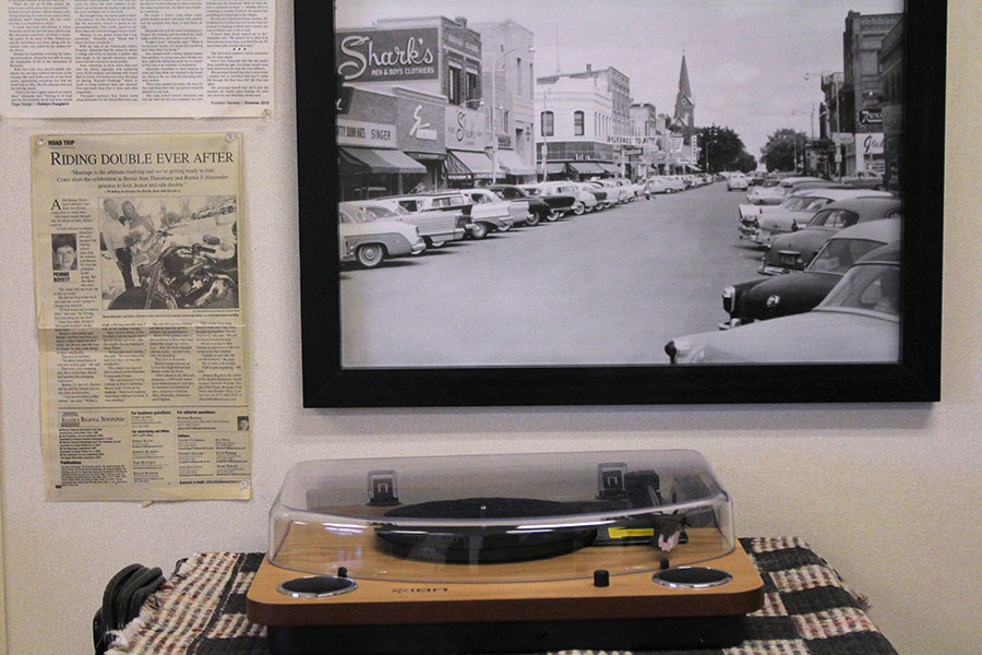 A+vintage+record+player+is+paired+with+a+newspaper+clipping+of+Alexander%27s+biker+wedding.