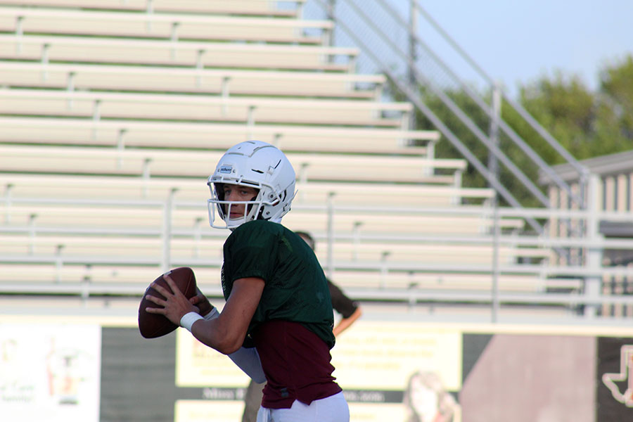 Junior quarterback Landon Webster (7) prepares to throw the ball at the home scrimmage against The Colony on Thursday, Aug. 22.
