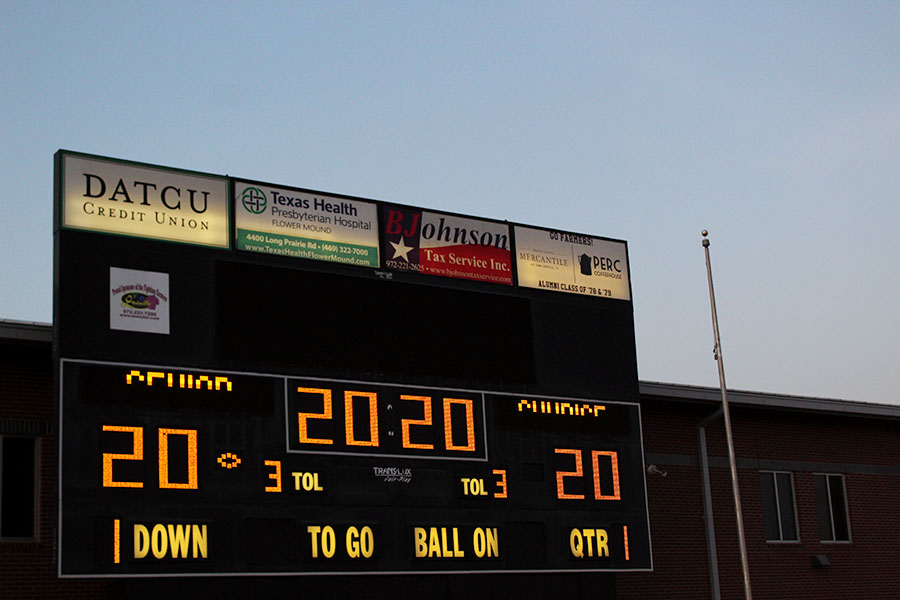 The+scoreboard+displays+the+number+%222020%22+and+the+words+%22Senior+Sunrise.%22