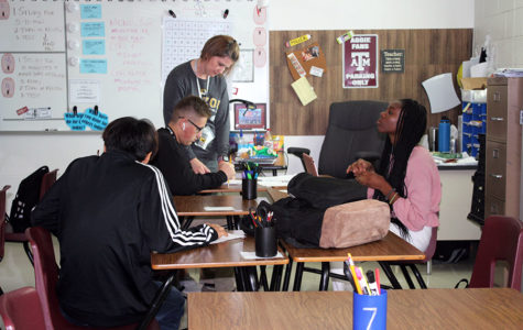 Geometry teacher Melanie Miller helps a student with a worksheet during block lunch on Tuesday, Sept. 10.