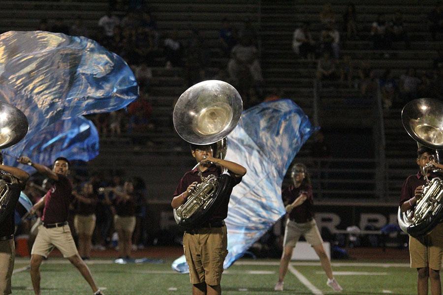 Freshman+Van+Tran+plays+the+tuba+during+the+band%27s+halftime+performance.