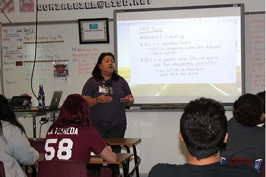 AP world history teacher Elizabeth Gonzalez talks about the short answer question (SAQ) on Wednesday, Sept. 18 during fourth period.