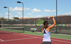 Sophomore Amber Rhodes serves a tennis ball during practice after school on Monday, Sept. 17 with the varsity team.