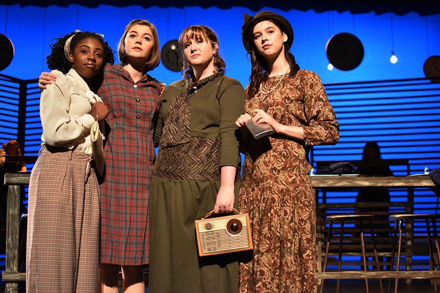 Juniors Eliana Jones and Madelyn Bloom and seniors Cadence Hindman and Sophia Cauduro pose together as the radium girls during a scene. Photo courtesy of Dawn Clyburn.