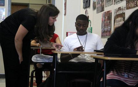 Math teacher Julie Williams assists senior Asa Battles during a test on Wednesday, Sept. 25.