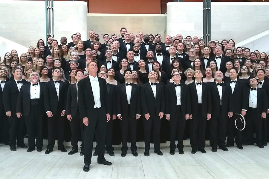 The choir section of the Dallas Symphony Chorus takes a group photo.