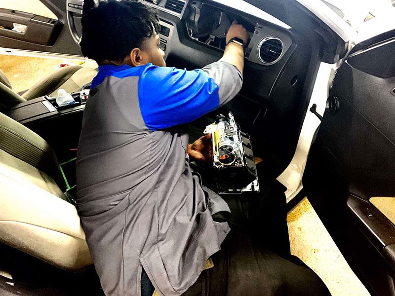 Senior Avante Bond fixes an airbag at Sam Pack's Five Star Ford Lewisville on Thursday, Feb. 13.