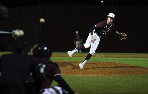 Senior Trey Martin (6) throws a curve ball during the game against Rider High School on Thursday, Feb. 27.