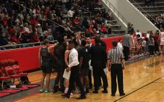 The boys' basketball team huddles together during the game against Marcus High School on Tuesday, Feb. 11.