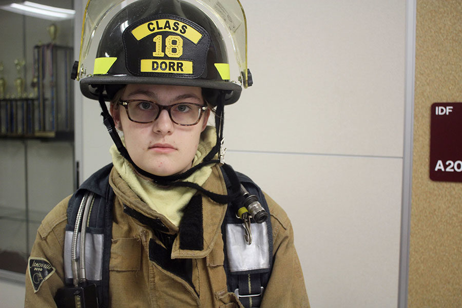 Senior+Haley+Dorr+dons+her+firefighting+gear+before+school+on+Tuesday%2C+Oct.+22.