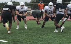 Seniors Michael Coronati (56) and Damarea Sheppard (74) complete a lineman drill during practice on Thursday, Sept. 10.