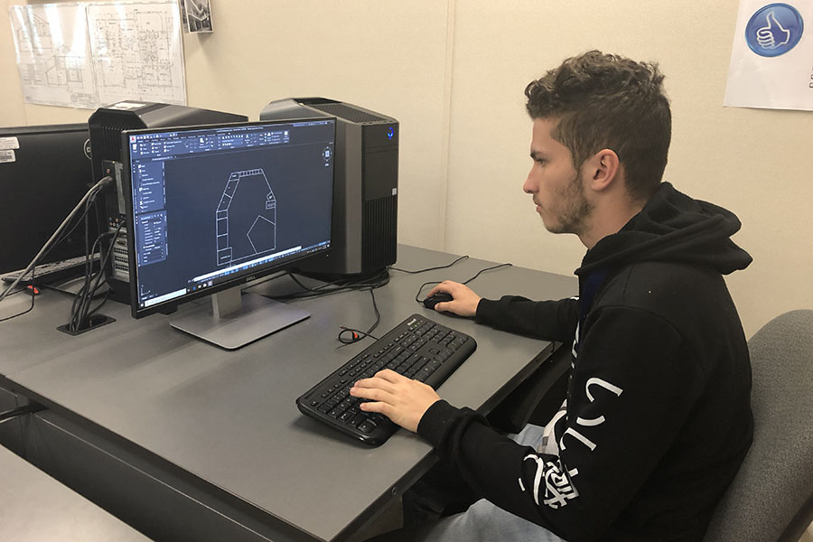Senior Jagger Odom works diligently on a design for the Technology Student Association on Tuesday, March 10. Courtesy of Jagger Odom.