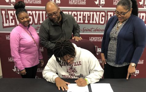 Senior Khristian Versey signs to Southern Nazarene University on Wednesday, Feb. 5. Courtesy of Allison Stamey.
