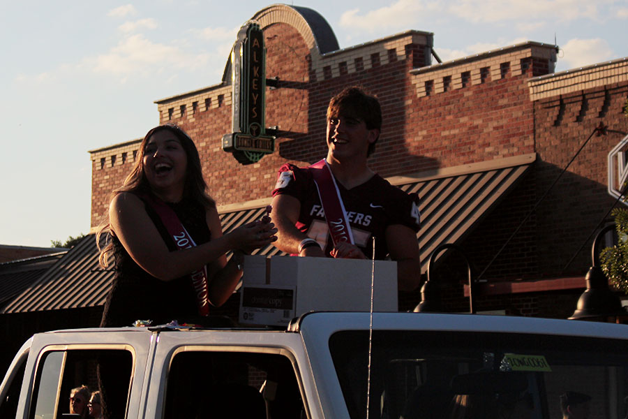 Senior princess Kayla Rios and senior prince Luke Halter ride in the homecoming parade together on Wednesday, Oct. 2.