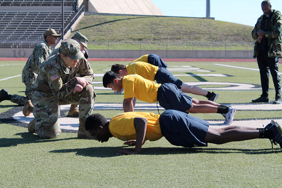 NJROTC students perform push ups at the Cowtown Classic Drill on Friday, Nov. 1. Courtesy of Mark Ortiz.