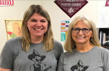 History teachers Sarah Dowdy and Bessie Alexander pose for a photo in their matching Farmer shirts. Courtesy of Bessie Alexander.