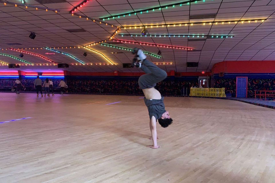 Senior+Vinlyin+Hill+performs+an+invert+handstand+during+work+on+Thursday%2C+Dec.+12.+Courtesy+of+Dawson+Dominguez.
