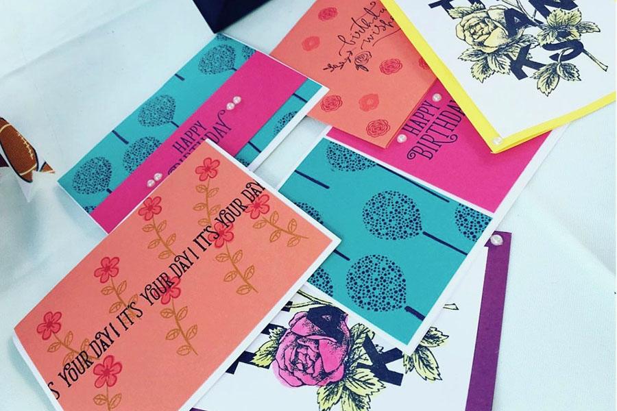 Freshman Alivia Allen's handmade cards spread out over her table during a local craft fair. Courtesy of Alivia Allen.