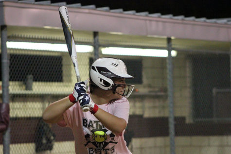 Senior softball captain Allie Barentine focuses on the pitcher as she prepares to swing during the Battle of the Bats game on Wednesday, Oct. 23.