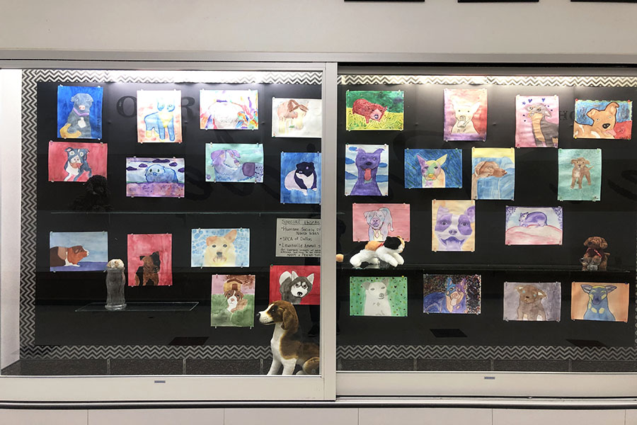 Students' watercolor projects are located in a display case at Killough.