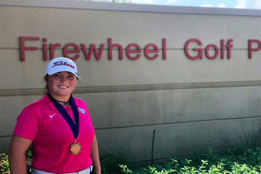 Junior Ashlee Johnson wins third place on Thursday, Oct. 3 at the Firewheel Pink Out tournament. Courtesy of Julie Lowrey.