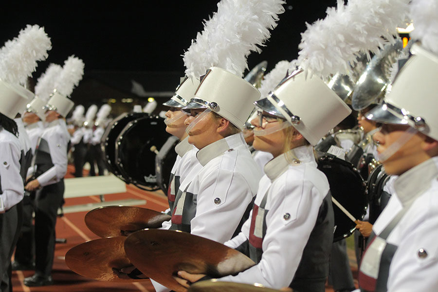 The+cymbal+line+walks+off+the+field+in+the+band%27s+%22LHS%22+formation+after+the+halftime+show+at+the+away+game+against+Flower+Mound+on+Friday%2C+Sept.+27.