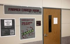 Posters line the walls in front of the career room, one advertising the career expo event that will be on Tuesday, March 24 in the B gym from 11:30 a.m. to 5 p.m.