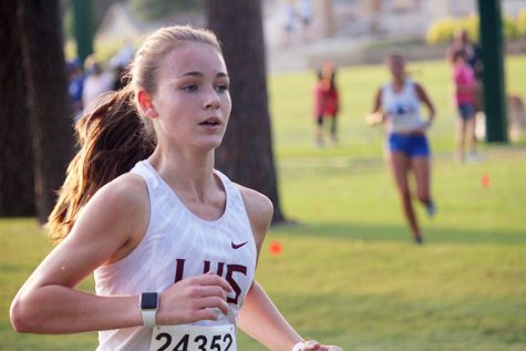 Sophomore girls' varsity runner Trinity Trotter races to catch up with first place at the Marcus Invitational on Friday, Sept. 18. Trotter won the varsity girls' division with a time of 11:31.86.