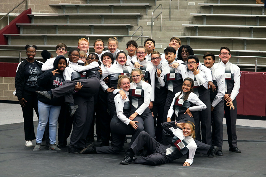 Drumline members pose after their host competition on Saturday, Nov. 9.